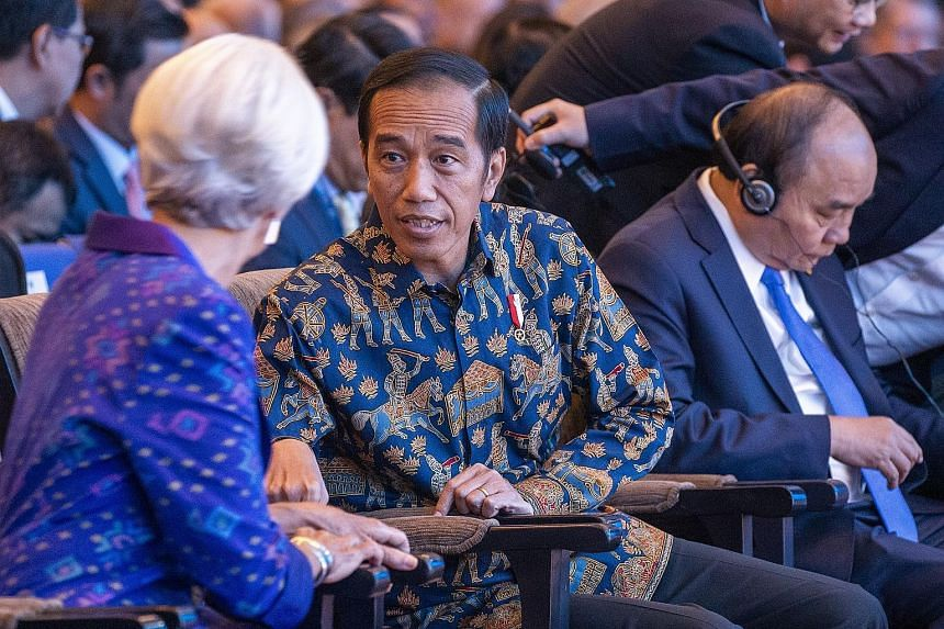 "Indonesian President Joko Widodo and IMF managing director Christine Lagarde at the IMF-World Bank annual meetings in Nusa Dua, Bali, yesterday. Ms Lagarde proposed a ""new multilateralism"" that is ""more inclusive, more people-centred and more result-"