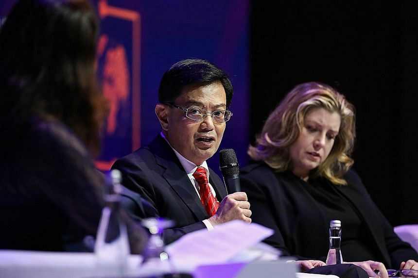 Finance Minister Heng Swee Keat at the IMF-World Bank annual meetings in Nusa Dua, Bali, yesterday. He told reporters the Oxfam report was wrong in its analysis of how Singapore tackled the rich-poor gap.