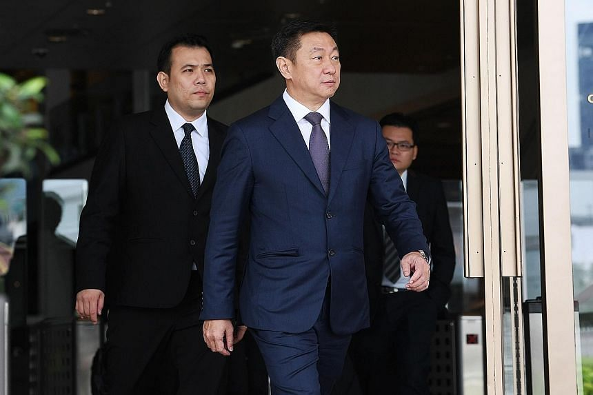 PwC partner Goh Thien Phong leaving the Supreme Court yesterday. His firm looked into the financial management of Punggol East by AHTC, and found that the town council racked up $400,000 in extra fees in calling a tender for a new conservancy and cle
