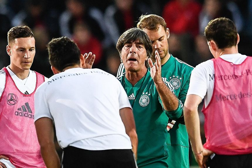 Germany head coach Joachim Low instructing his players during training in Berlin on Tuesday before they travelled to Amsterdam to face the Netherlands in their Uefa Nations League match tonight.