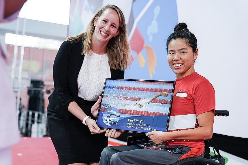 Yip Pin Xiu receiving the World Para Series' best female High Support Needs Athlete (S/SB1-3). award. She is the only Asian among the four winners.