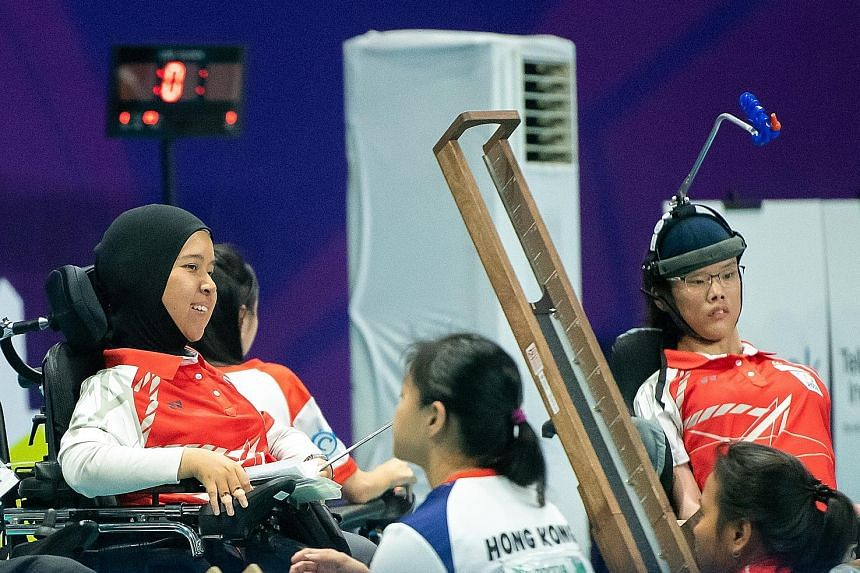 Boccia players Nurulasyiqah Taha (left) and Toh Sze Ning combined to win the silver medal in the mixed pairs BC3 event at the Asian Para Games yesterday. The duo lost 4-2 to Hong Kong in the final.