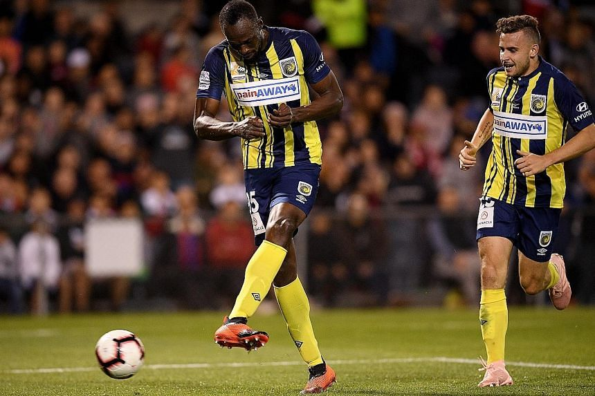 Usain Bolt scores with a tap-in for his second goal for the Central Coast Mariners during an A-League trial match against Macarthur South West United yesterday. The world's fastest man is hoping to realise his dream of becoming a professional footbal