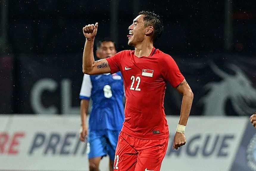 Winger Gabriel Quak celebrates after scoring the second goal in Singapore's 2-0 friendly win over Mongolia at Bishan Stadium last night. The win maintained the Lions' unbeaten run under interim national coach Fandi Ahmad after three games.