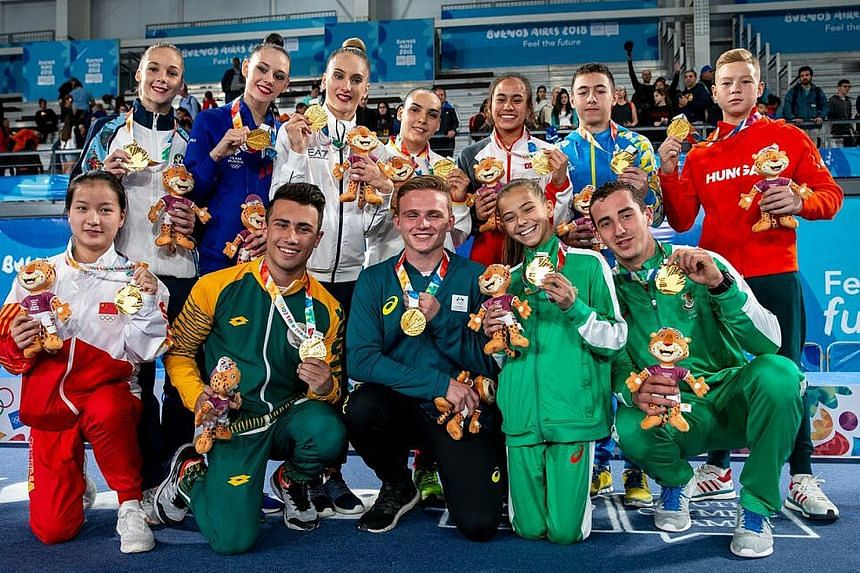 Tamara Ong won gold as part of Team Simone Biles Orange in a multi-discipline team event. The team (above) tallied 293 points from 21 exercises. Medals from mixed-nation events are not added to a country's overall medal tally.