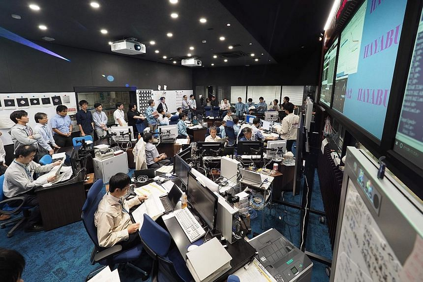 Employees working in a control room to operate the Hayabusa2 mission in Sagamihara, Japan, last month. The probe has already amassed valuable data since it approached the Ryugu asteroid in June.