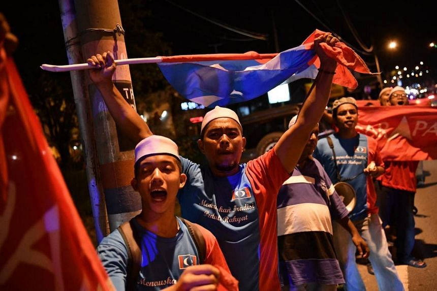 Supporters celebrating the announcement of Datuk Seri Anwar Ibrahim's victory at Port Dickson on Oct 13, 2018.
