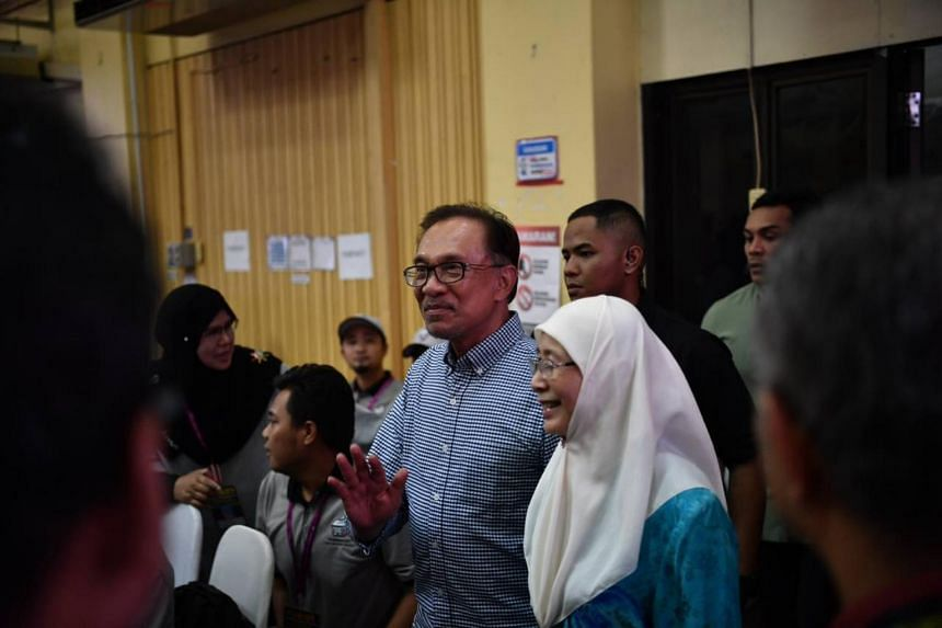 Datuk Seri Anwar Ibrahim, accompanied by his wife Wan Azizah, arriving at the counting centre after the announcement of voting results in Port Dickson, on Oct 13, 2018.