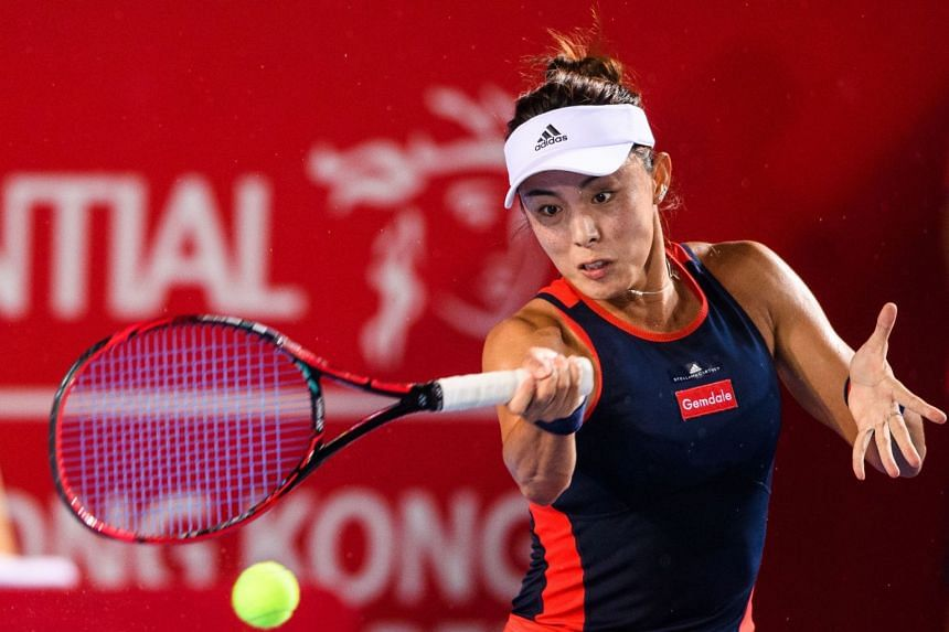 China's Wang Qiang hits a return during her quarter-final women's singles match against Elina Svitolina at the Hong Kong Open tennis tournament on Oct 12, 2018.