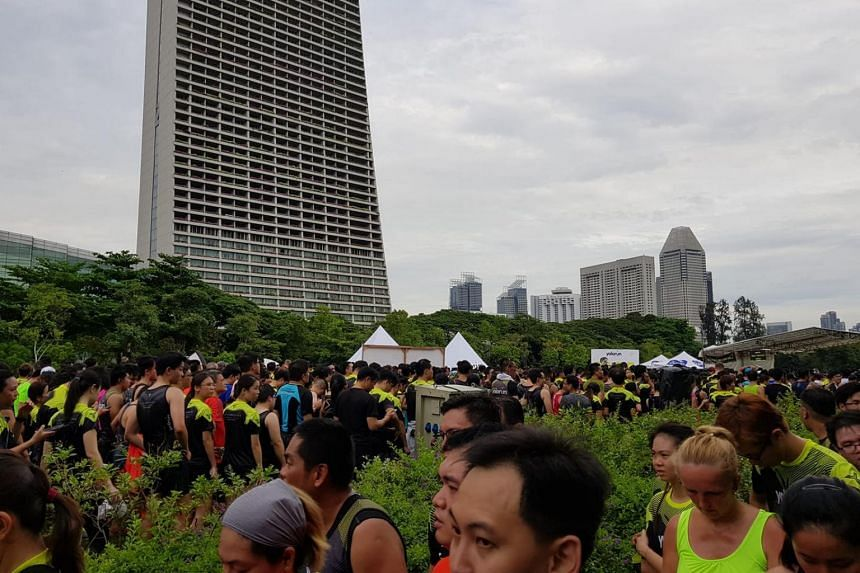 Long queues formed by runners collecting post-run items such as foam rollers and medals at the Yolo Run on Oct 13, 2018.