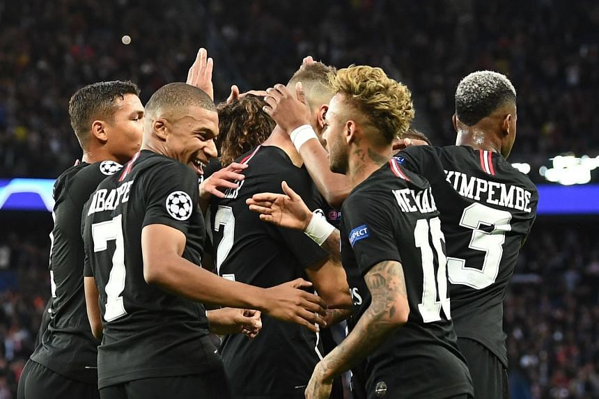 PSG's Kylian MBappe (left) and Neymar celebrate a goal during the match, which PSG won 6-1.