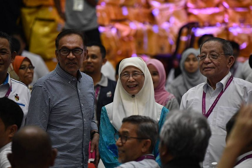 (From left) Datuk Seri Anwar Ibrahim, his wife Wan Azizah Wan Ismail and Democratic Action Party leader Lim Kit Siang at the counting centre after the announcement of voting results.