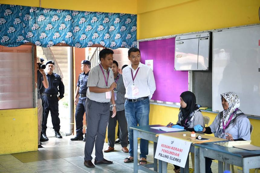 Independent candidate Mohd Saiful Bukhari Azlan arrives at a voting centre at a school in Linggi on Oct 13, 2018.