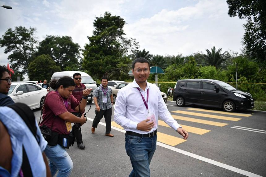Independent candidate Mohd Saiful Bukhari Azlan arriving at the voting centre in a school in Linggi.