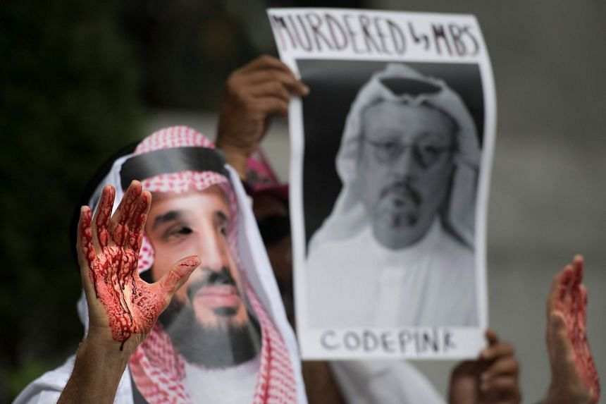 A demonstrator dressed as Saudi Arabian Crown Prince Mohammed bin Salman with blood on his hands protests outside the Saudi Embassy in Washington, DC.