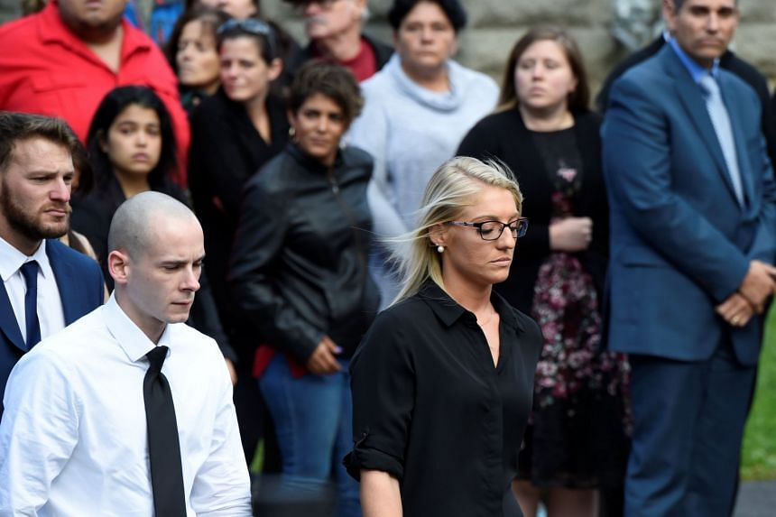 Mourners attend a combined wake for eight victims, including four sisters and two brothers, from the crash.
