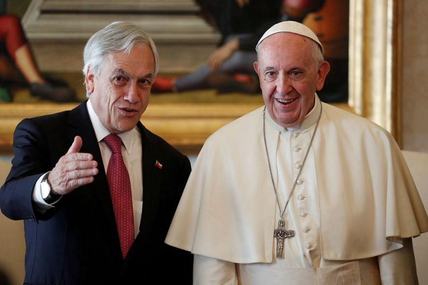 Pope Francis with Chile's President Sebastian Pinera during a private audience at the Vatican.