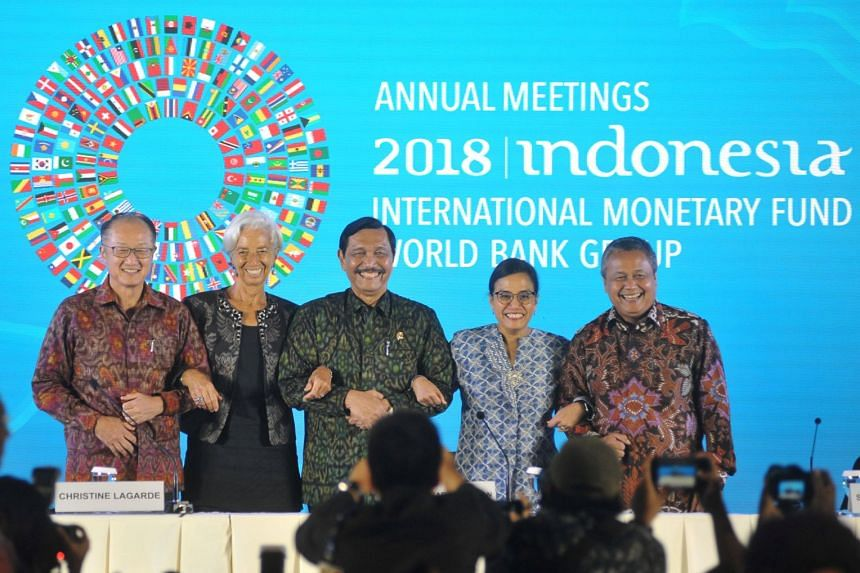 """IMF managing director Christine Lagarde (second from left) said countries must """"de-escalate the tensions, and open and reform the dialogue"""" in order to address the trade issues."""