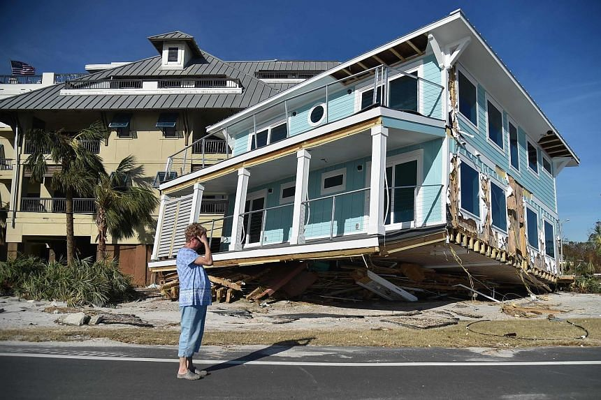 More than 940,000 homes and businesses on the US East Coast have been without power, and it could be weeks before power is restored to the most damaged parts of Florida. Rescue teams, hampered by power and telephone outages, have been going door to d