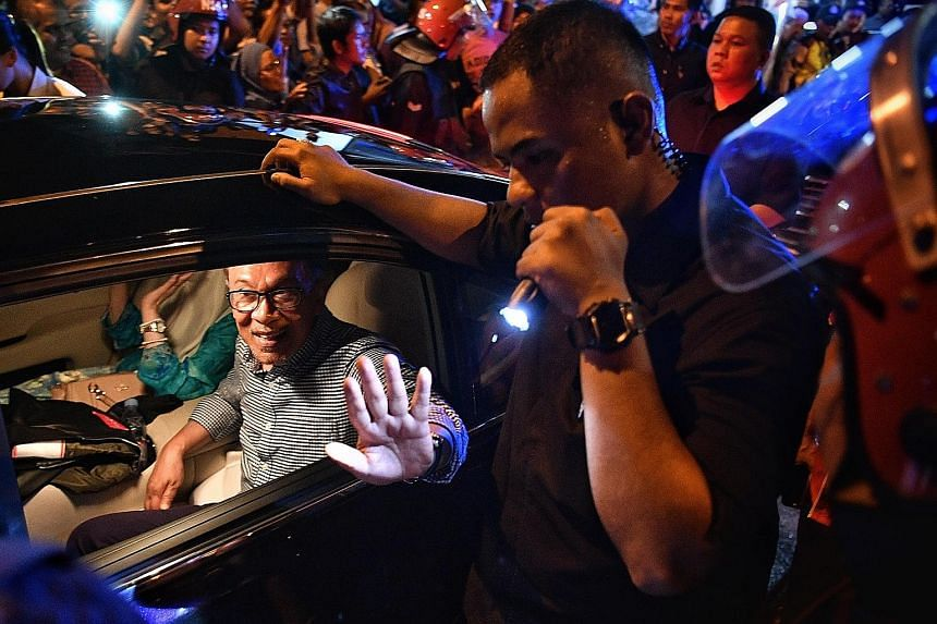 Datuk Seri Anwar Ibrahim outside the official vote counting centre in Port Dickson yesterday. He won the by-election with a majority of 23,560 votes, a bigger margin of victory than that achieved by previous MP Danyal Balagopal Abdullah in the May ge