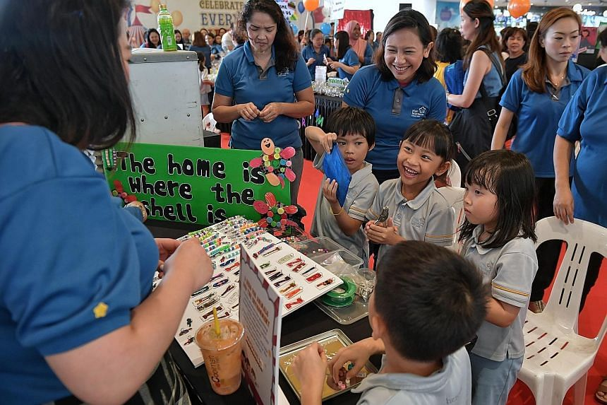 Pre-schoolers were in charge at a Downtown East fun fair yesterday, selling handicraft (above) and running game stalls to raise money for The Straits Times School Pocket Money Fund and Business Times Budding Artists Fund.