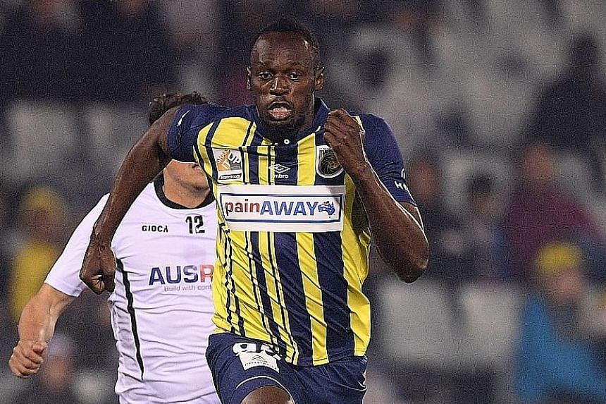 Bolt scores two goals for A-League football club Central Coast Mariners in his first start for the club against Macarthur South West United in Sydney on Friday.