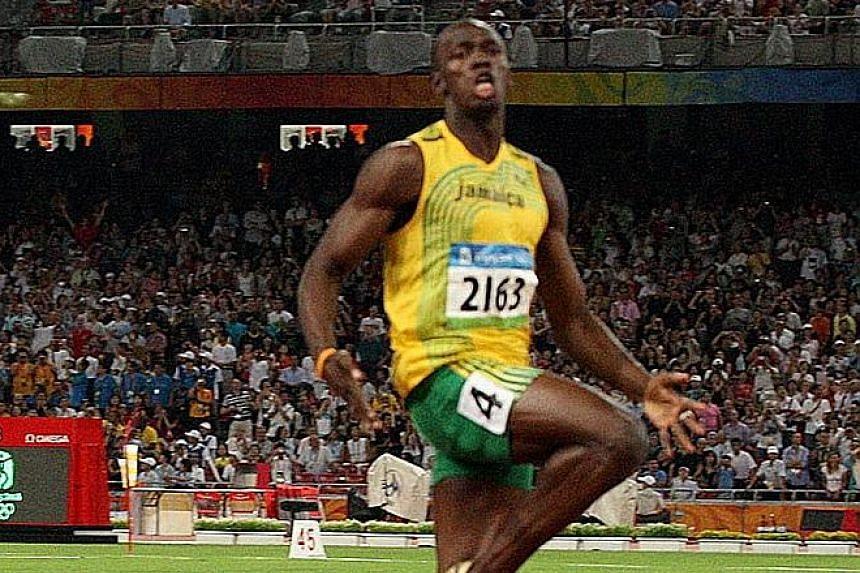 Usain Bolt wins the 100m final with ease at the Beijing Olympics, clocking 9.69sec.