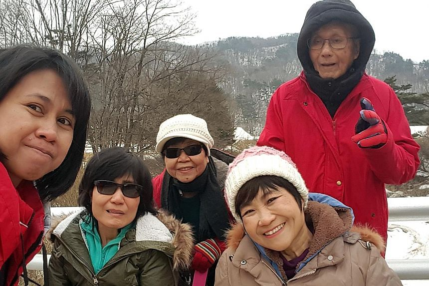 Ms Chia Yong Yong (foreground, wearing cap) with (from left) helper Dewi Muliana, sister Leslie, mother Teo Kee Wei and father Chia Cheng Heng during a trip to South Korea in January.