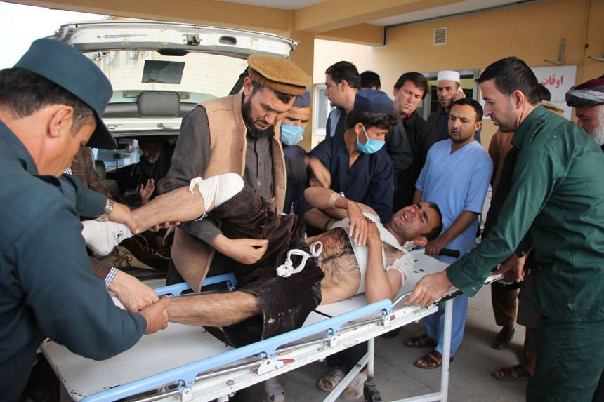 Afghan volunteers transport an injured man to a hospital following the attack.
