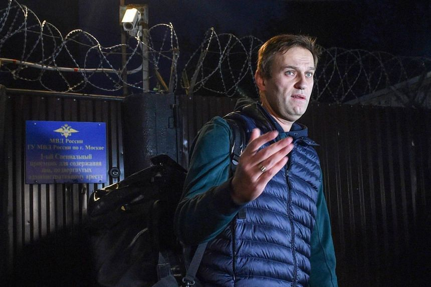 Russian opposition leader Alexei Navalny speaking to the media as he leaves the detention centre in Moscow early on Oct 14, 2018.