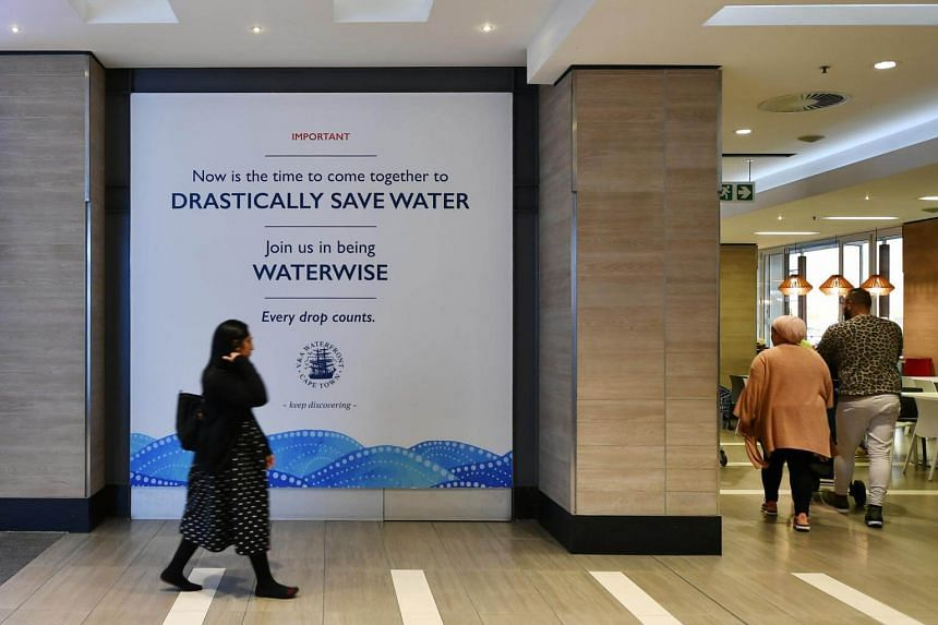 A poster on saving water in V & A Waterfront in Cape Town, South Africa.