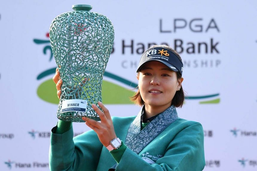 South Korea's Chun In-gee poses with the trophy after winning the KEB Hana Bank Championship at the Sky 72 Golf Club in Incheon, South Korea on Oct 14, 2018.