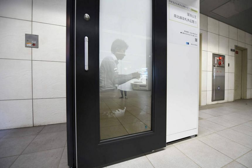 A Fuji Xerox employee working in a cubicle installed at a subway station in Tokyo, Japan, on July 3, 2018.