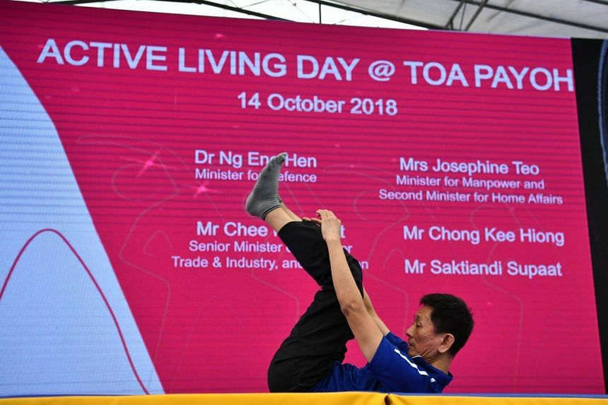 Mr Alvin Lau, 56, a therapy assistant, demonstrating a rolling technique to minimise the risk of injury during a fall.