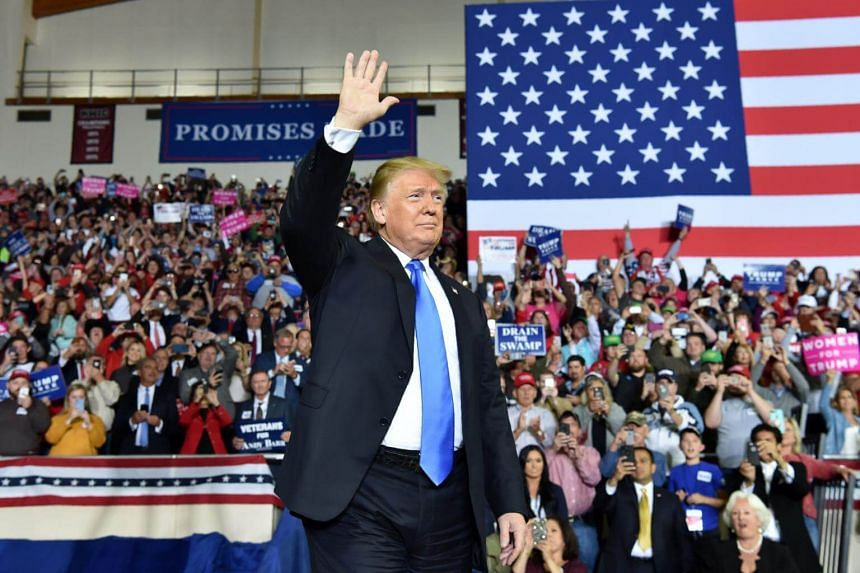 US President Donald Trump arrives at a rally at the Eastern Kentucky University, in Richmond, Kentucky, on Oct 13, 2018.