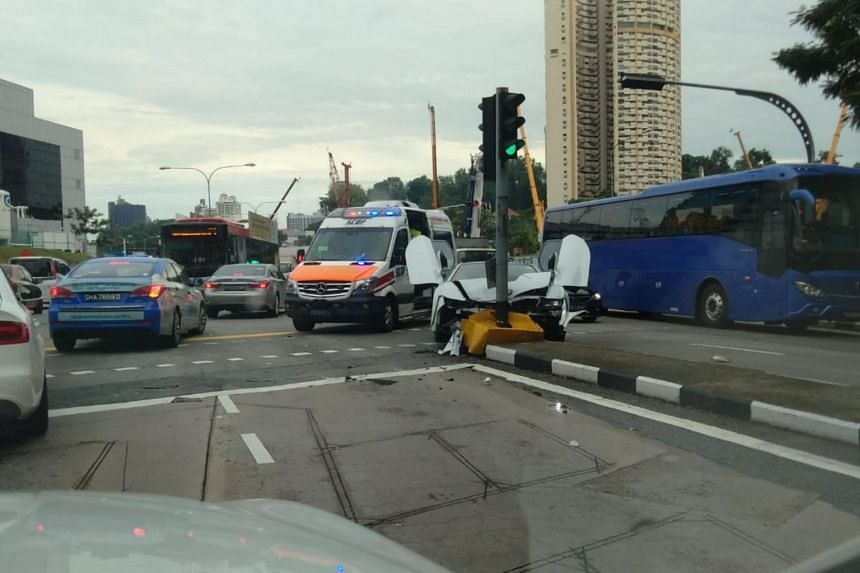 A white BMW sports car crashed into a traffic light at the junction of New Bridge Road and Cantonment Road, on Oct 13, 2018.