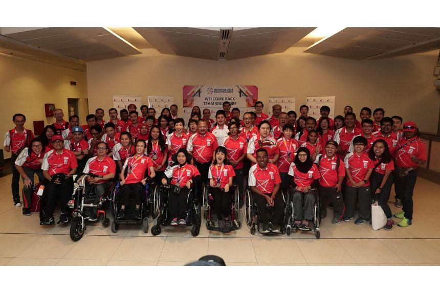 Team Singapore athletes returning from a historic showing at the Asian Para Games in Jakarta, on Oct 14, 2018.