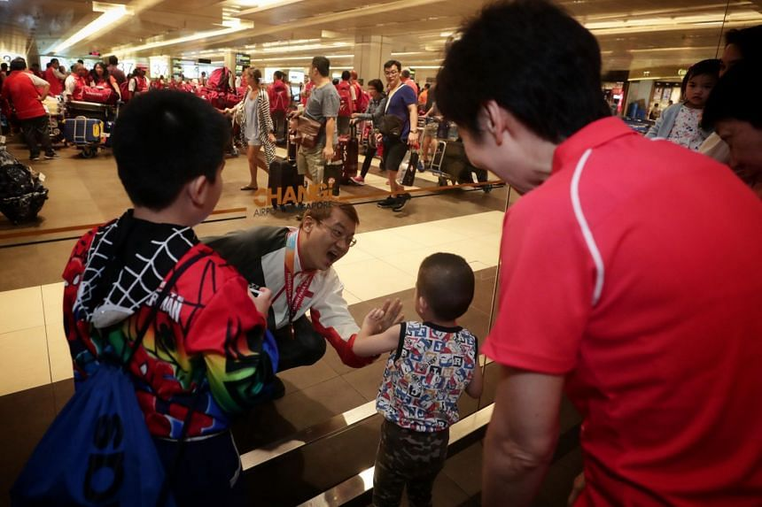 Rex Tan Swang Hee is greeted by his sons at the arrival hall.