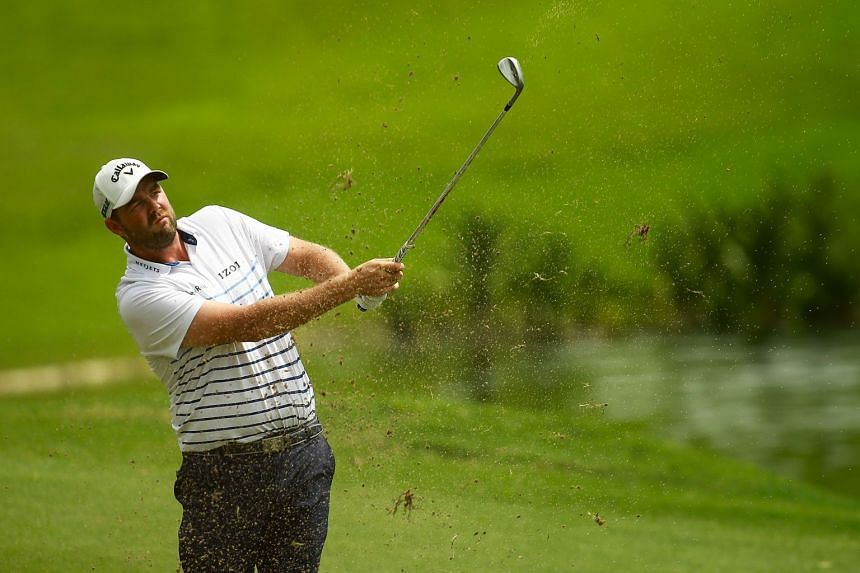 Marc Leishman plays a shot on the 16th fairway during the final round of the 2018 CIMB Classic golf tournament in Kuala Lumpur, on Oct 14, 2018.