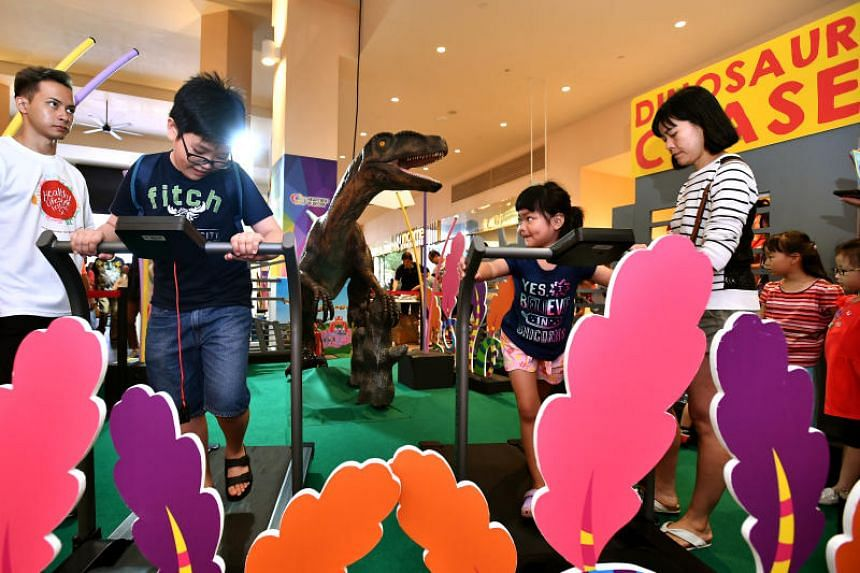 Ryan Teo, (second from left) 10, a Primary 4 student, at the Dinosaur Chase booth during the Healthy Lifestyle Festival SG 2018.