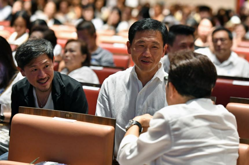 SPH Deputy CEO Anthony Tan (left) and Education Minister Ong Ye Kung speaks with Jack Neo (back view) at the concert. ST PHOTO: CHONG JUN LIANG