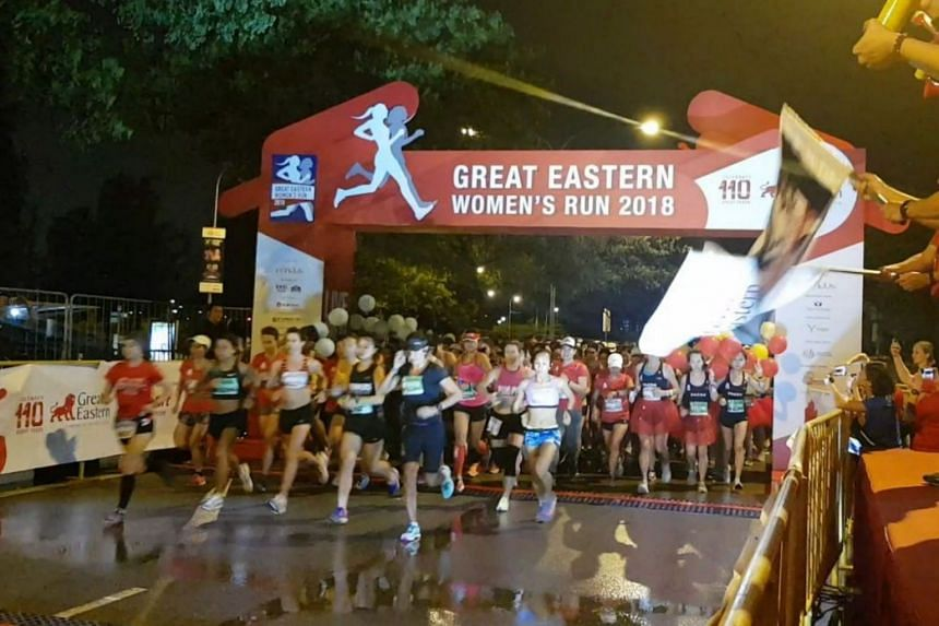 Runners in the 21.1km category of the Great Eastern Women's Run were flagged off on Nicoll Highway at 6.15am on Sunday morning (Oct 14), after a delay of one hour due to a pre-dawn thunderstorm.