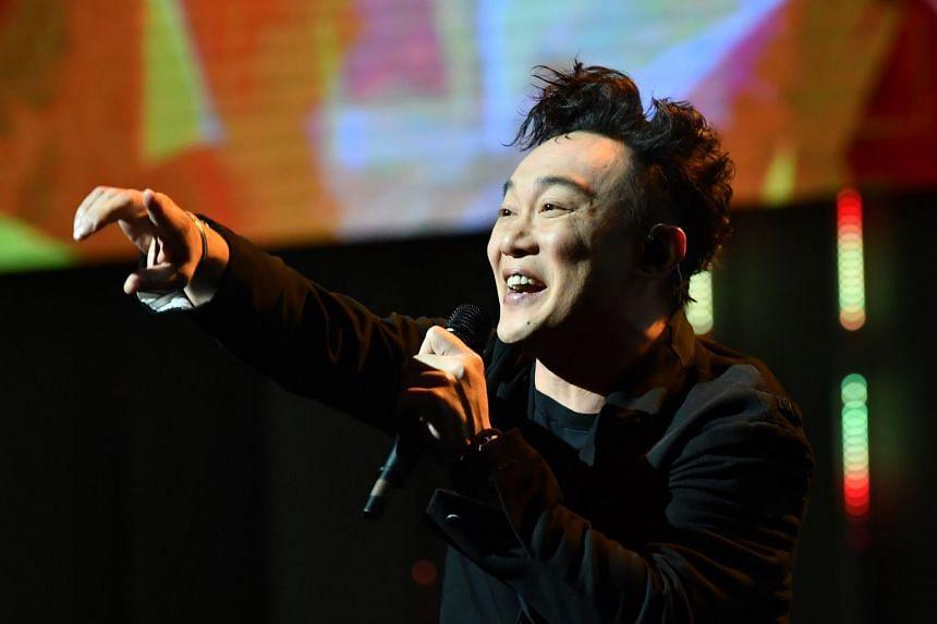 Hong Kong star Eason Chan performing at the President's Star Charity 2018.