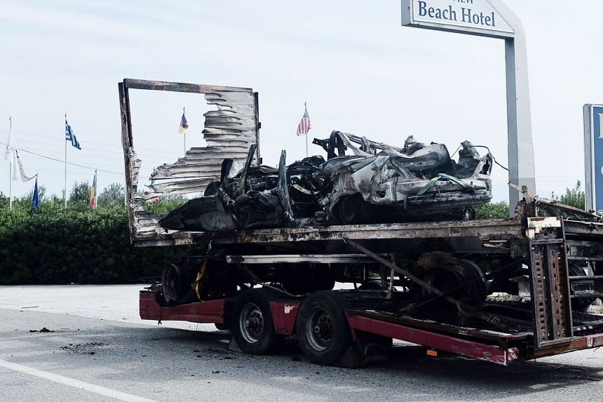 Eleven people died in northern Greece yesterday after a car believed to be carrying immigrants crashed head-on with a truck at high speed and burst into flames, police said. Firefighters recovered 11 bodies from the car (left). Media reports said 10