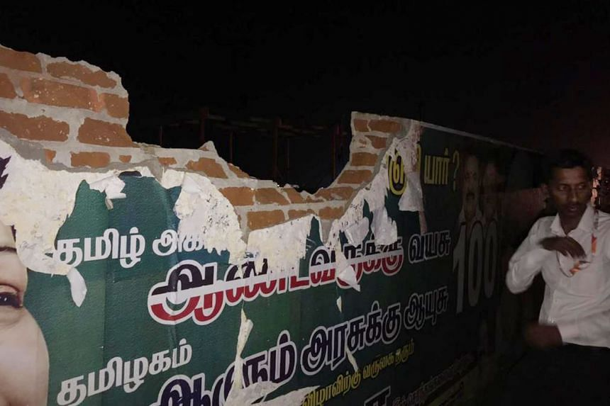 Fuselage of the shredded hull of the plane that hit the airport perimeter wall (below) in Tamil Nadu state last Friday. The jet landed safely in Mumbai four hours after the incident. The two pilots of the plane have been grounded, pending an investig