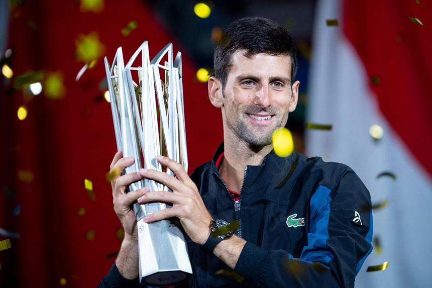 Novak Djokovic of Serbia with his trophy after beating Borna Coric of Croatia in their final at the Shanghai Masters tennis tournament on Oct 14, 2018.