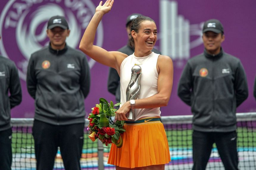 Caroline Garcia of France holds the trophy after winning the women's singles final match at the Tianjin Open tennis tournament, on Oct 14, 2018.