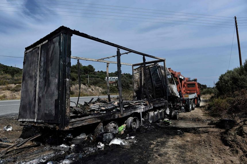 A burned truck is pictured in Sarakina, near Kavala, Northern Greece on Oct 13 2018.
