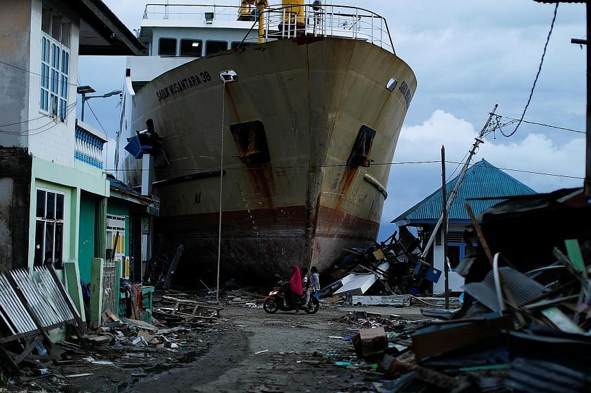 A stranded ship at a port hit by last month's deadly tsunami, triggered by a 7.4-magnitude tremor, in Palu in Central Sulawesi. The funds offered by the World Bank will go towards helping Indonesia shore up its defence against natural disasters, as w