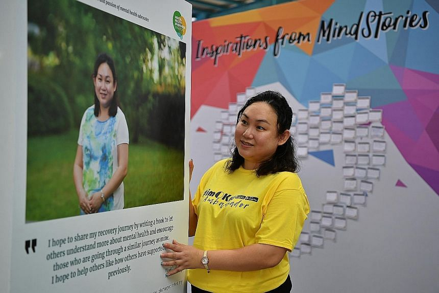 Ms Linda Chua, who was diagnosed with bipolar disorder, with the panel sharing her story at the MindStories exhibition at Ang Mo Kio Central Stage yesterday. The AMKFSC volunteer wants to help people overcome their own mental health disorders.